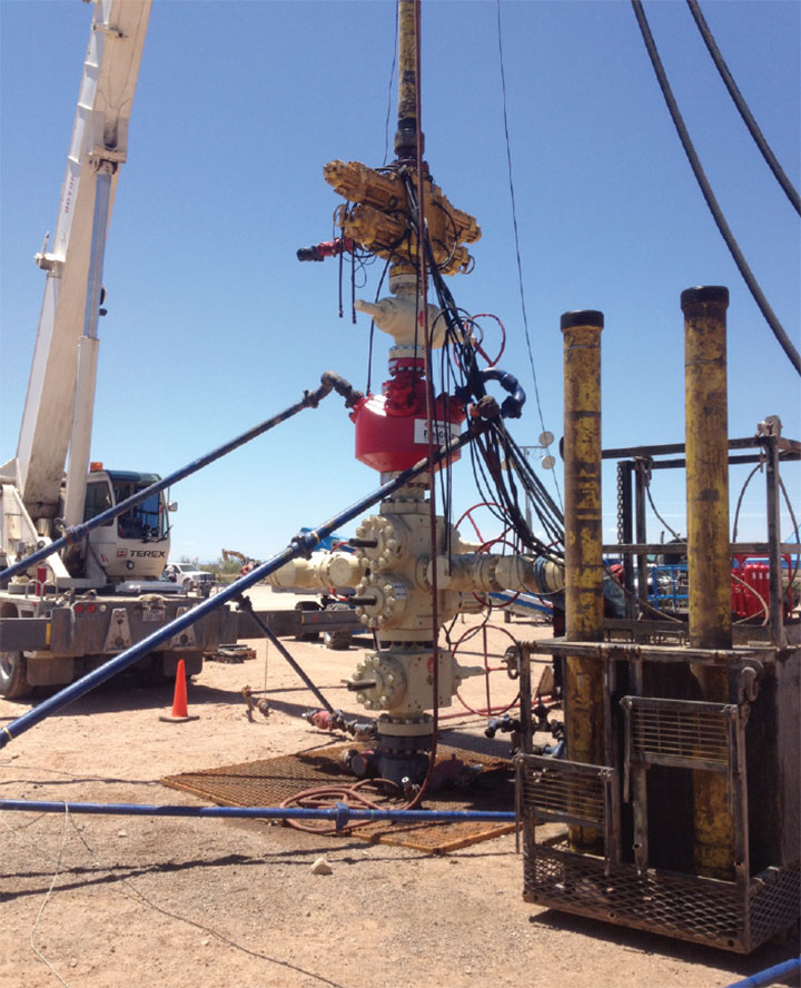 The CT isolation frack head functions as a barrier between the fluid entry ports of the frack head and OD of the CT.