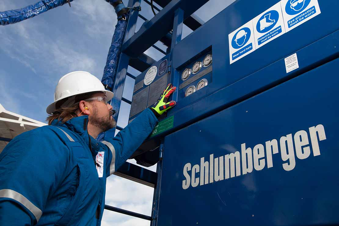 Schlumberger worker with appropriate ppe gear.