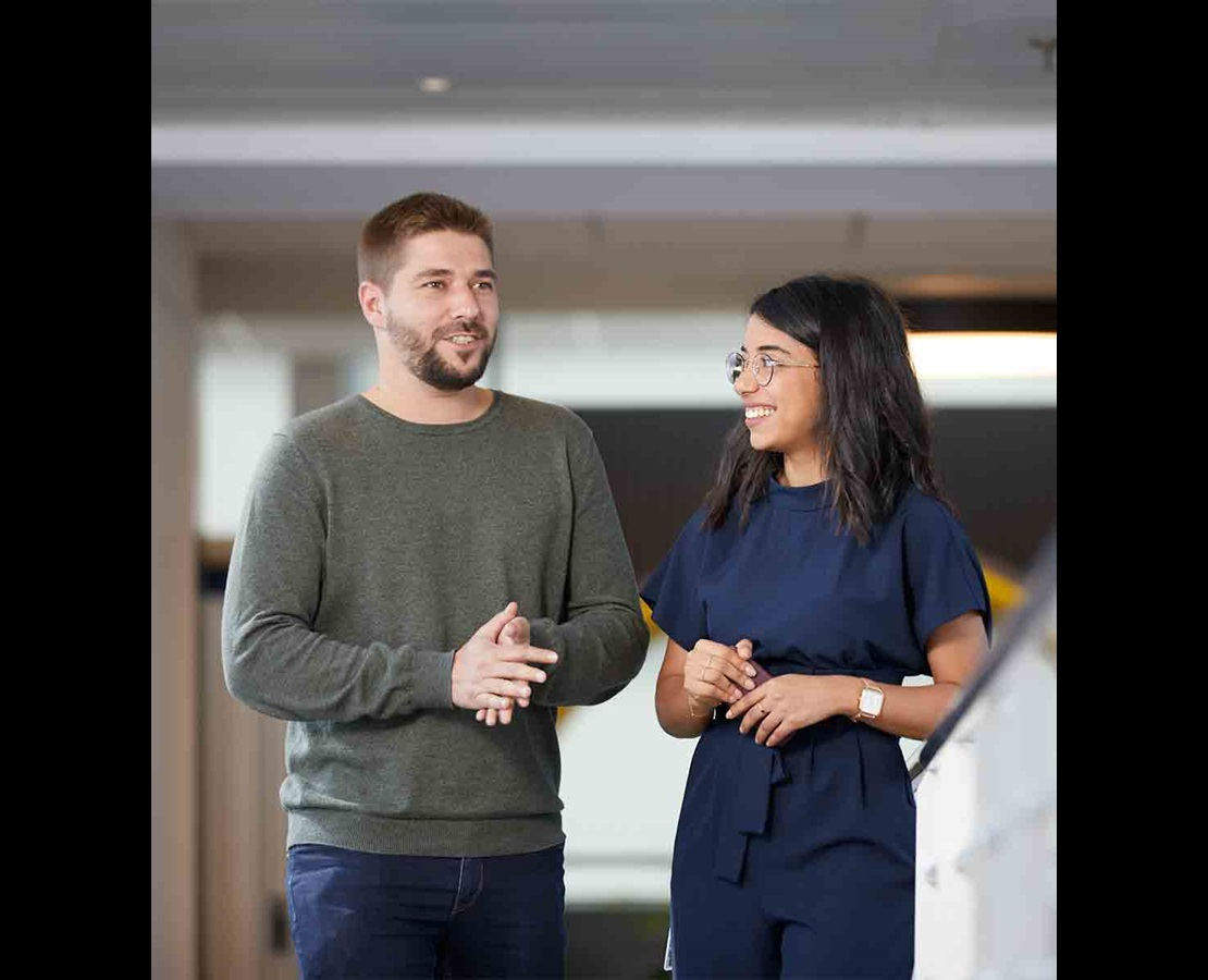 Photo of rig behind a hill of flowers.