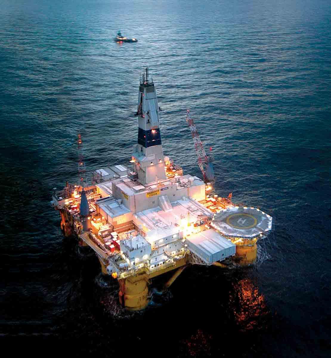 Offshore drilling platform in water.