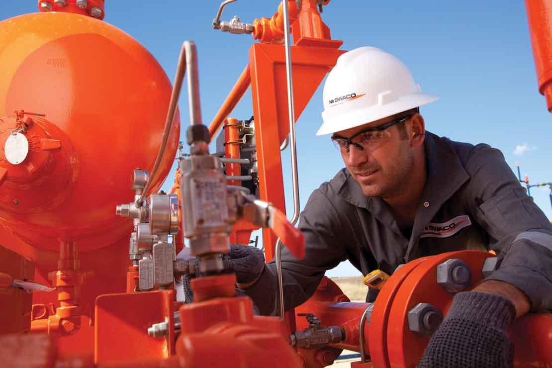 Operator inspecting a gas separator