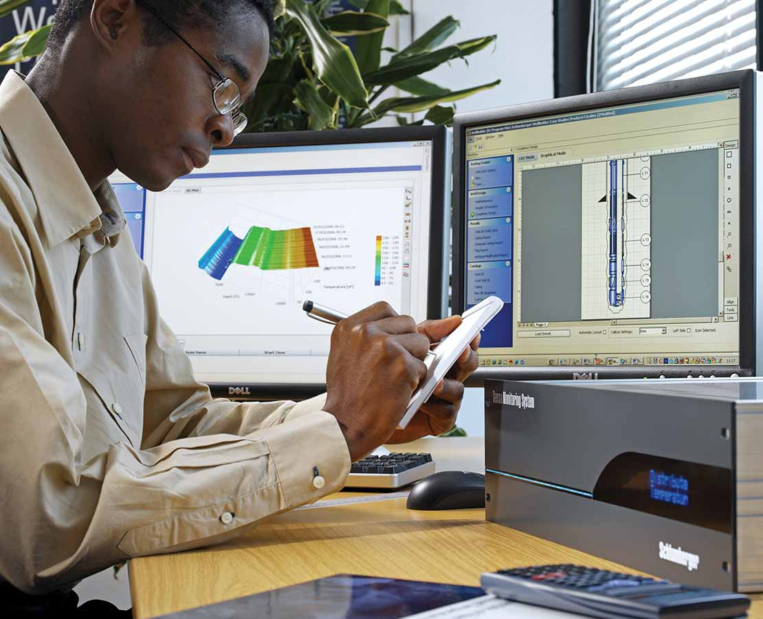 Schlumberger Worker Reviewing Distributed Measurement Systems Data