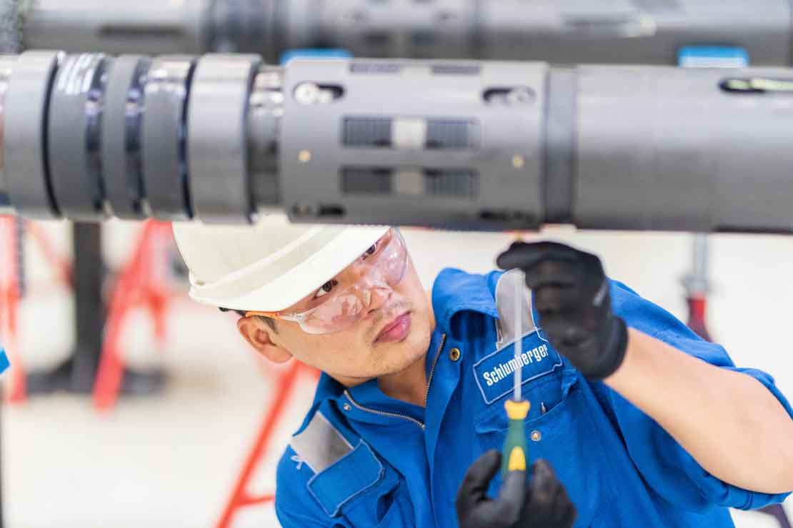 Schlumberger Worker Performing Maintenance on Service Packer