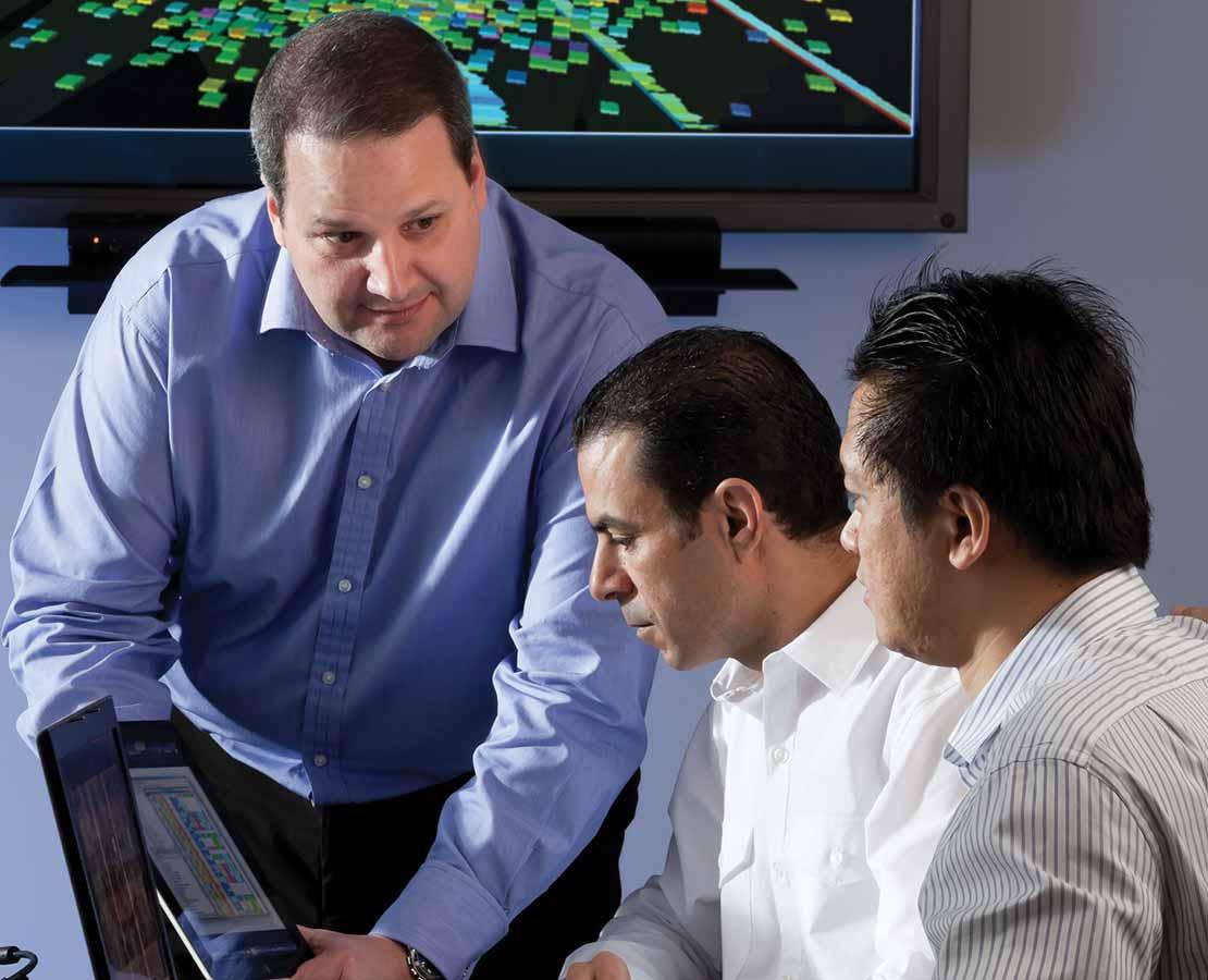Three Men Discussing Data