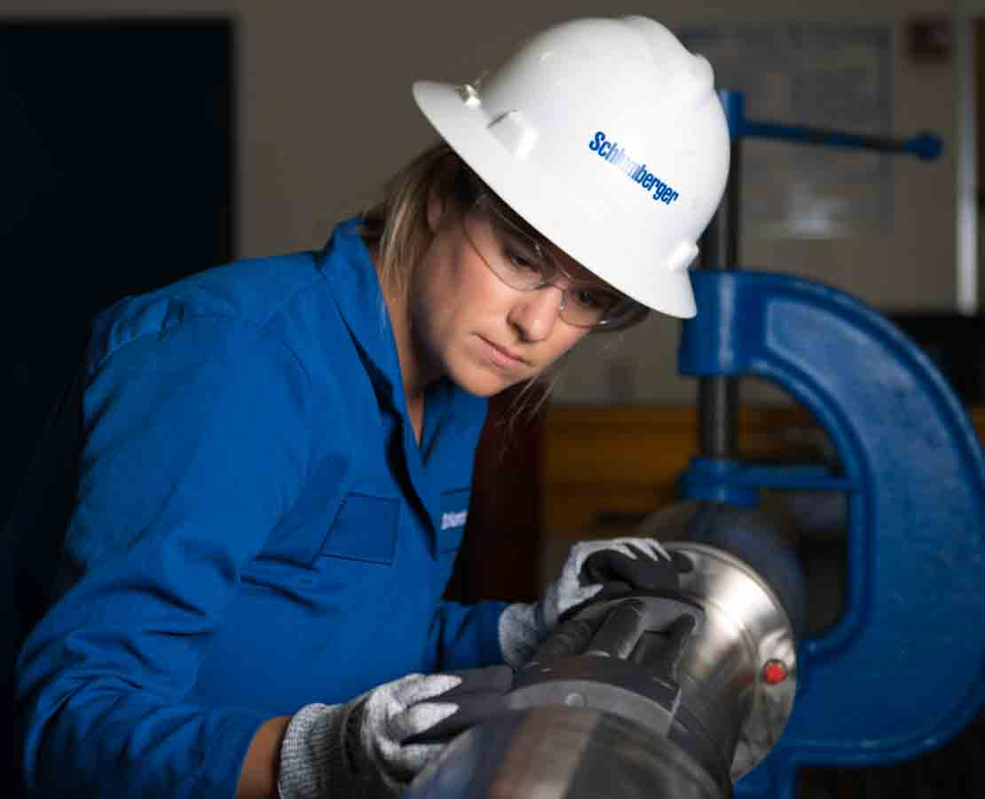 Schlumberger Worker Inspecting Safety Valve