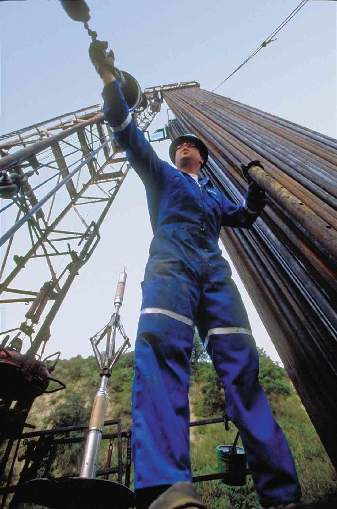A Schlumberger employee preparing the PowerCutter to be lowered in a well.