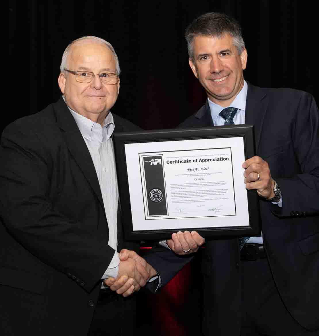 Rick Faircloth receiving framed API Citation of Achievement award.