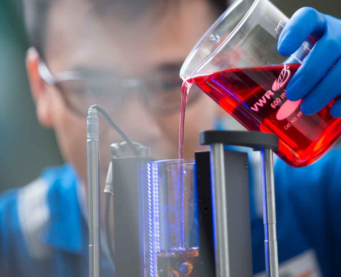 Laboratory worker testing clear brines