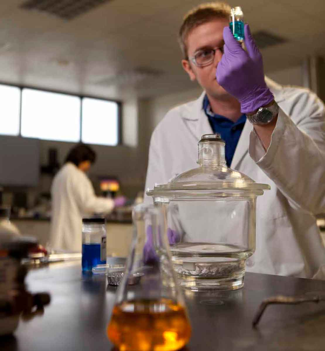 Worker looking at halide brines in laboratory