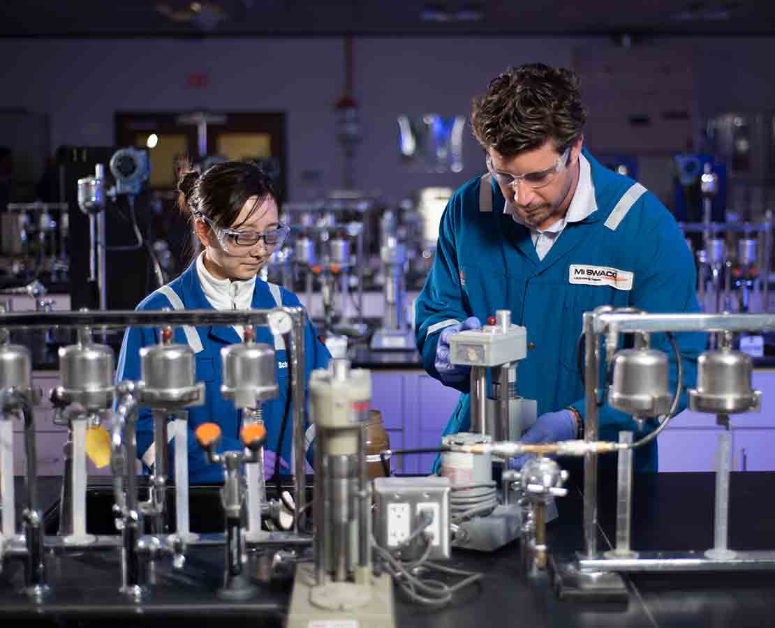 Schlumberger workers in the lab