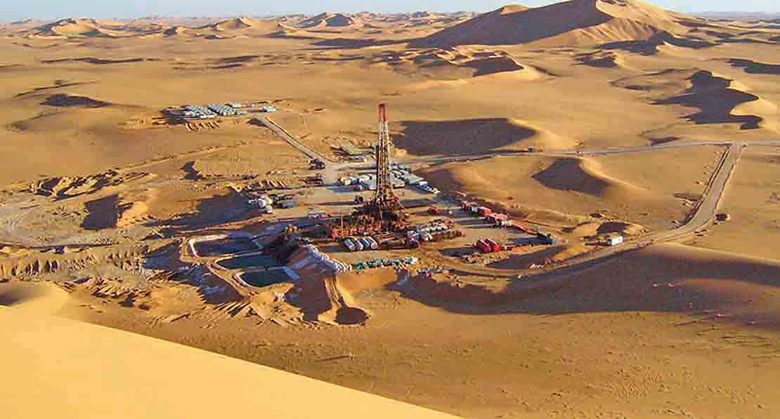 Aerial view of rig site in the desert.