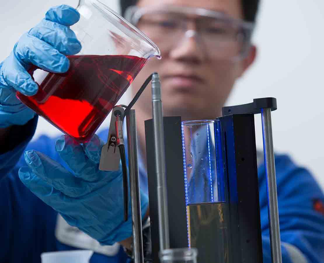 Lab worker testing liquids