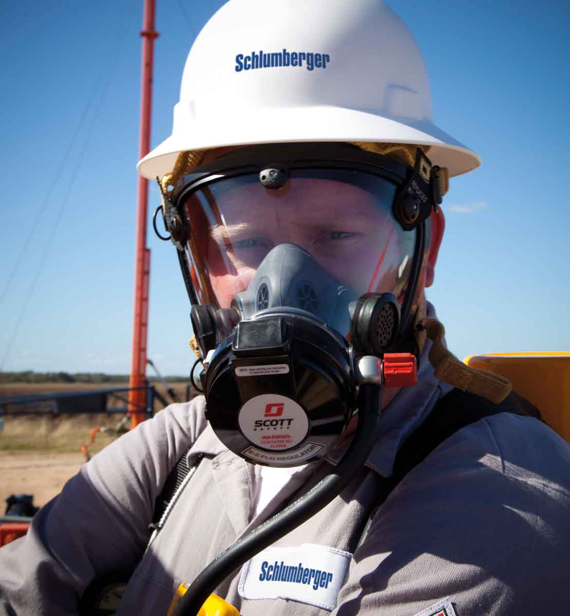 Worker in field wearing hydrogen sulfide mask protection