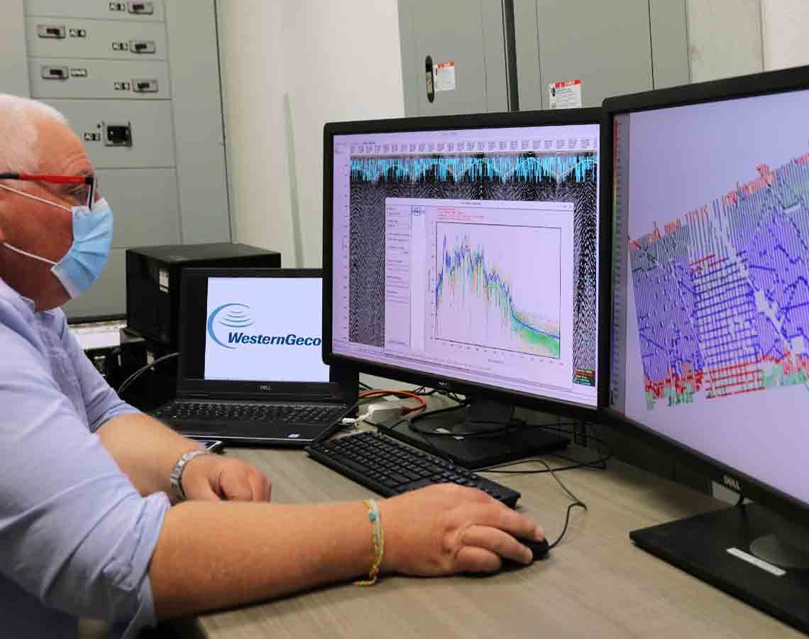 Person viewing seismic data acquired by eNode solution