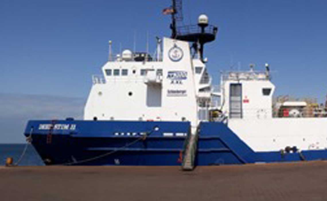 Blue-and-white DeepSTIM II vessel at the dock.