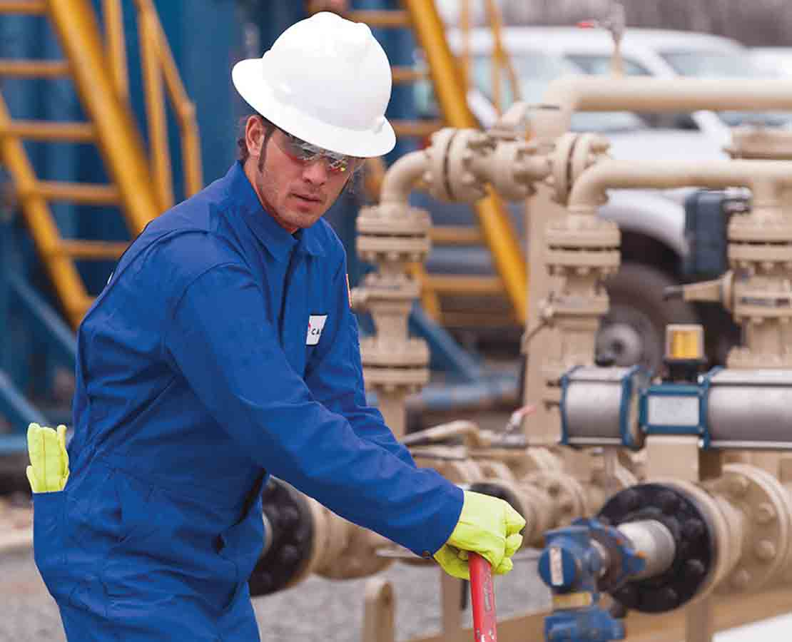 Schlumberger Worker Performing Maintenance on an Emergency Shutdown Valve