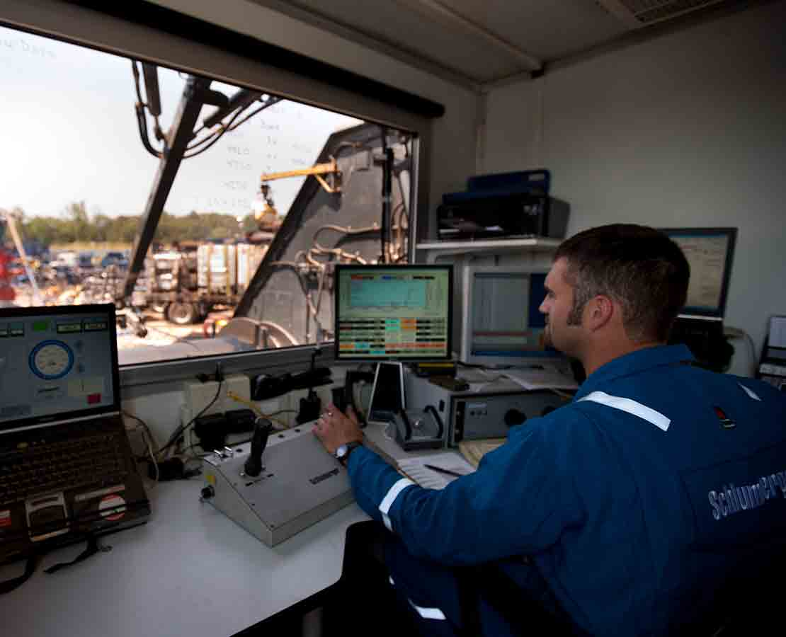 Schlumberger Worker on Rig Site Controlling Frac Flowback Equipment