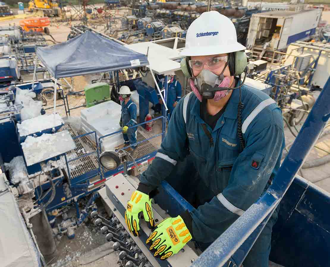 Schlumberger worker on rigsite during fracturing services operation.