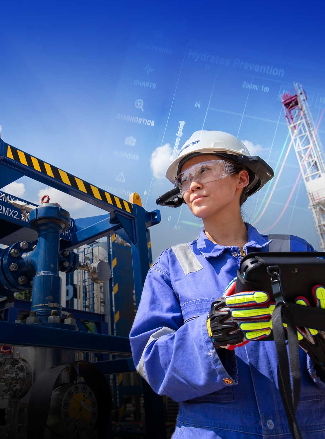Image of a woman with an iPad in front of the equipment and the land rig