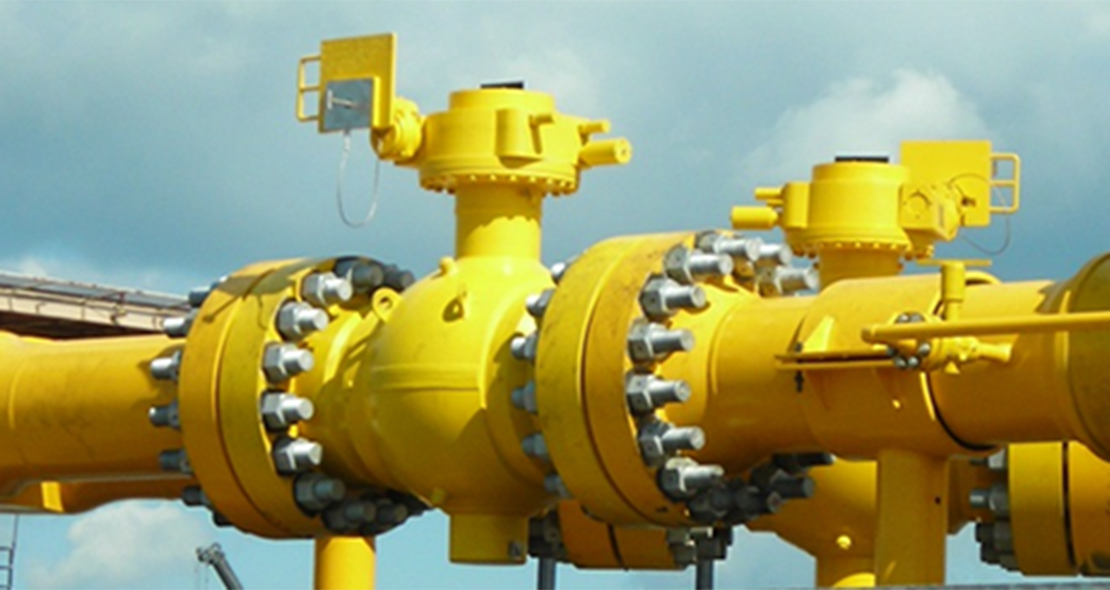 Yellow subsea valves against a blue sky.