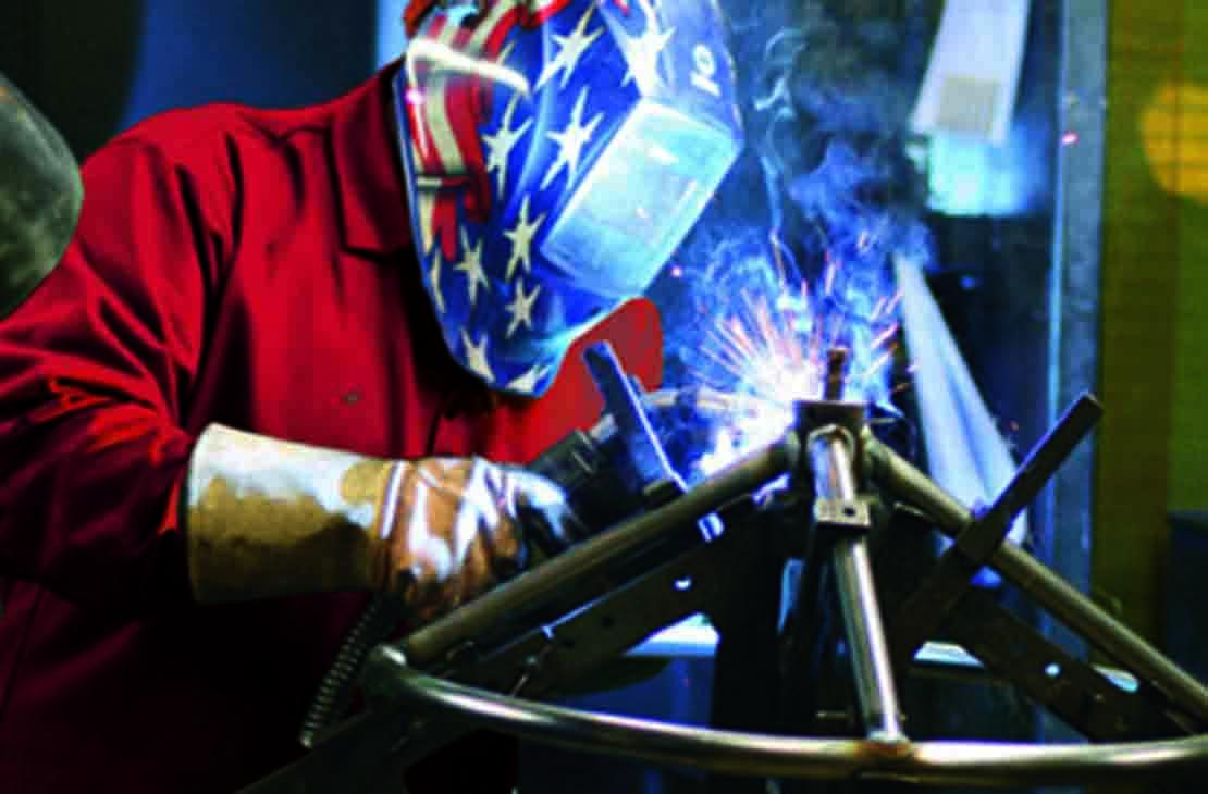 Cameron employee welding a DYNATORQUE handwheel.