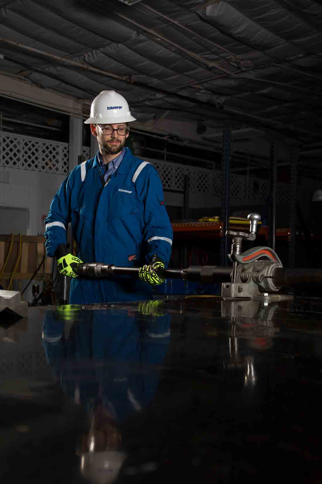 Schlumberger Employee in a lab holding the ACTive Xtreme tool.